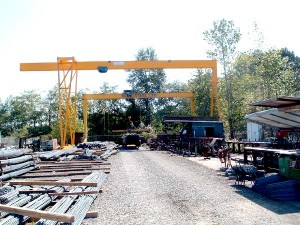 8 ton, single girder full gantry crane with 65' span plus 20' cantilever. This crane is designed with heavy duty components for re-bar yard service.
