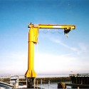 3 Ton Freestanding Jib Crane, 20' Mast Height, 20' Boom Length. Complete with epoxy paint and NEMA 4X stainless steel control enclosures for salt water marine environment.