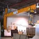 This 1 Ton wall bracket style jib crane was equipped with a vacuum lifter to handle slabs of granite.