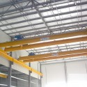 Two of four 15 Ton Top running double girder cranes supplied and installed complete with runway systems into a large machine shop operation by CRS CraneSystems.
