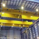 Two 100/15 ton, top running double girder cranes for heavy equipment maintenance at a major oil company facility located in Northern Alberta
