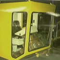 Fully enclosed heated/air conditioned operator cab complete with ergonomic operators chair and joystick style control console.